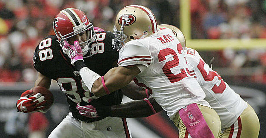 Atlanta Falcons tight end Tony Gonzalez (88) is stopped by San Francisco 49ers defenders Taylor Mays (23) and Patrick Willis (52) in the first half of an NFL football game at the Georgia Dome in Atlanta, Sunday, Oct. 3, 2010. Photo: John Amis, AP