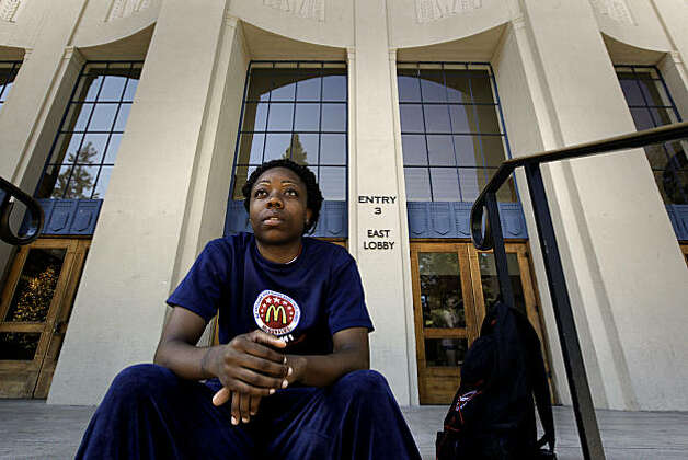 Tierra Rodgers sits on the steps of Haas Pavilion, on Thursday Sept. 23, 2010, where she used to play basketball for the Cal Bears. Tierra Rodgers, is the Hunters Point native who was a basketball star at Sacred Heart Cathedral and whose father was shot dead at halftime of one of her games. She went on to play at UC Berkeley and almost died from a heart condition. Photo: Michael Macor, The Chronicle
