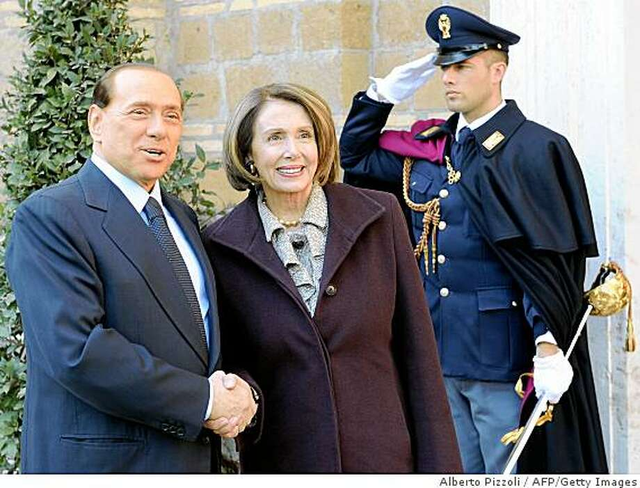 "Italian prime Minister Silvio Berlusconi (L) greets US Speaker of the House Nancy Pelosi (C) during their meeting at Villa Madama in Rome February 17, 2009. ""You can look forward to that new era of cooperation and that possibly will start with Afghanistan,"" Pelosi told a news conference yesterday, adding tongue in cheek: ""not necessarily alphabetically."" AFP PHOTO / ALBERTO PIZZOLI (Photo credit should read ALBERTO PIZZOLI/AFP/Getty Images) Photo: Alberto Pizzoli, AFP/Getty Images"