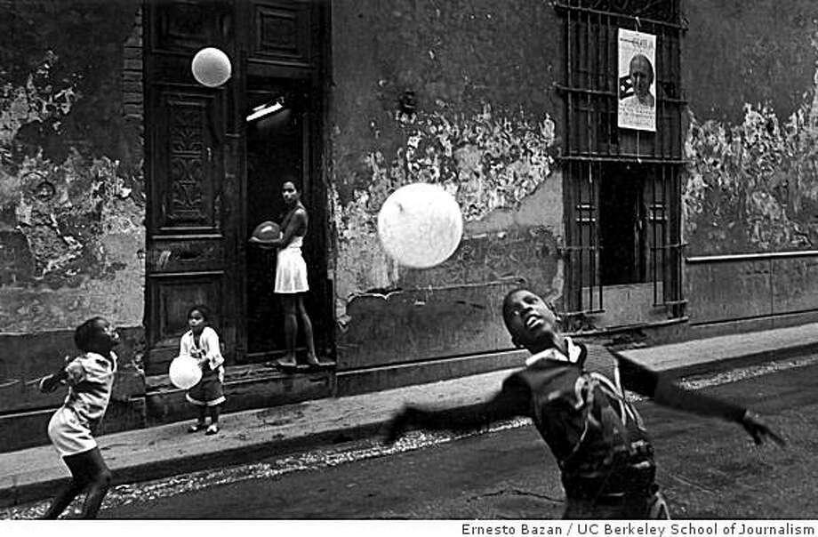 """Children Playing with Balloons"" (1995) gelatin silver print by Ernesto BazanChildren Playing with BallonsHavana,Cuba, 1995 Photo: Ernesto Bazan, UC Berkeley School Of Journalism"