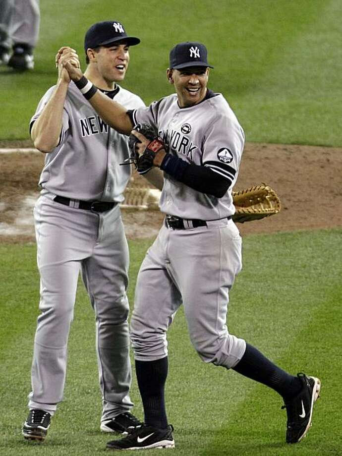New York Yankees' Mark Teixeira, left, and Alex Rodriguez celebrate after Game 2 of baseball's American League Division Series against the Minnesota Twins,  Thursday, Oct. 7, 2010, in Minneapolis. The Yankees won 5-2 to take a 2-0 lead in the series. Photo: Paul Battaglia, AP