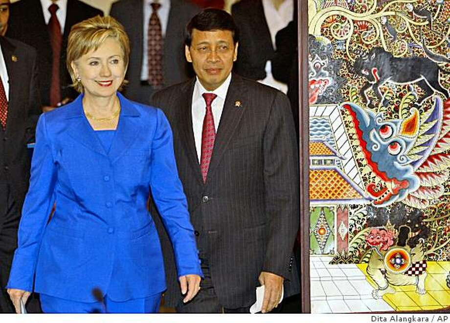 Secretary of State Hillary Rodham Clinton, left, walks with Indonesian Foreign Minister Hassan Wirajuda prior to a press conference following their meeting in Jakarta, Indonesia, Wednesday, Feb. 18, 2009.  Secretary of State Clinton is continuing the Obama administration's efforts to rehabilitate America's image abroad, especially with Muslims, during a visit to Indonesia that began Wednesday. (AP Photo/Dita Alangkara) Photo: Dita Alangkara, AP