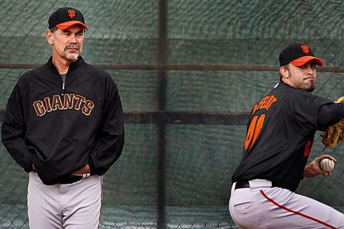 Giants manager Bruce Bochy kept an eye on left handed pitcher Jeremy Affeldt during workouts Monday February 22, 2010. Scenes from the San Francisco Giants and Oakland Athletics spring training campaigns of 2010 in Scottsdale and Phoenix, Arizona.