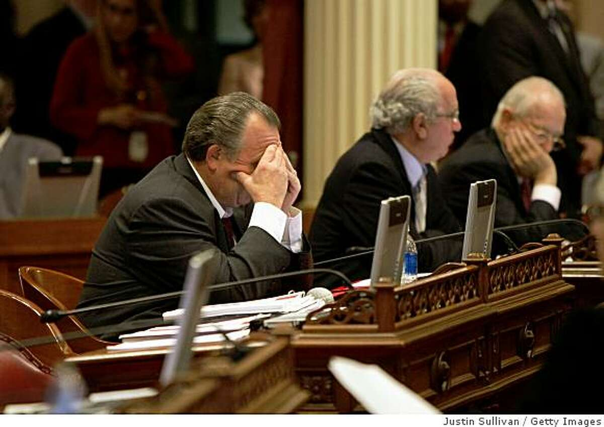 SACRAMENTO, CA - FEBRUARY 17: California state Sen. Robert Dutton (R-Rancho Cucamonga) holds his head in his hands during a session of the state Senate February 17, 2009 in Sacramento, California. The legislature is working to hammer out a budget that avoids thousands of layoffs and avoids briging state-funded construction projects to a halt. (Photo by Justin Sullivan/Getty Images)