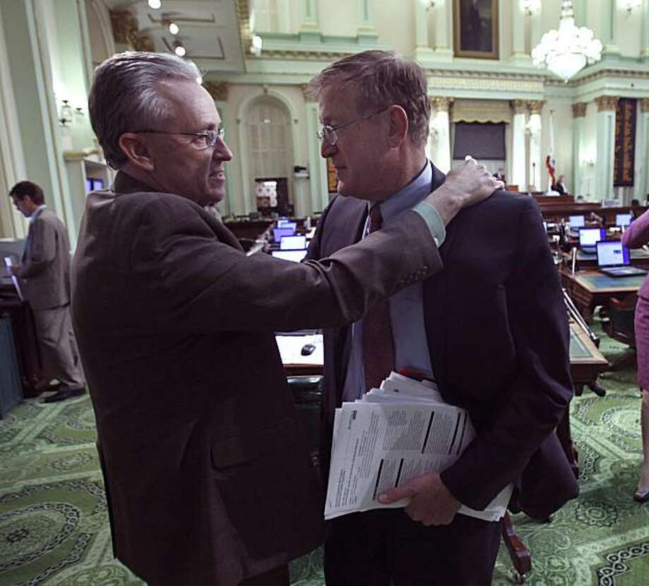 Assemblyman Danny Gilmore, R-Bakersfield, left, says good bye to Assemblyman Paul Cook, R-Yucca Valley,  after an all night session ended at the Capitol  in Sacramento, Calif., Friday, Oct. 8, 2010. The Assembly approved the state budget packaged worked out between Gov. Arnold Schwarzenegger and legislative leaders, to close a $19 billion deficit and end the longest budget impasse in the state's history.  The measures were sent to the Senate for final approval.   Gilmore is retiring from the Assembly after one term. Photo: Rich Pedroncelli, AP