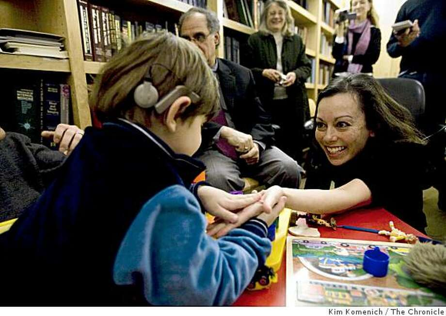 Cochlear implant specialist Dr. Colleen Polite plays with Mustafa Ghazwan, 3, of Baquba, Iraq on Tuesday, Feb. 17, 2009  after she activated his implant of at the University of California San Francisco Medical Center in San Francisco, Calif. Mustafa lost his hearing in Baquba on June 17, 2007 when U.S. forces bombed his neighbors' home. Photo: Kim Komenich, The Chronicle