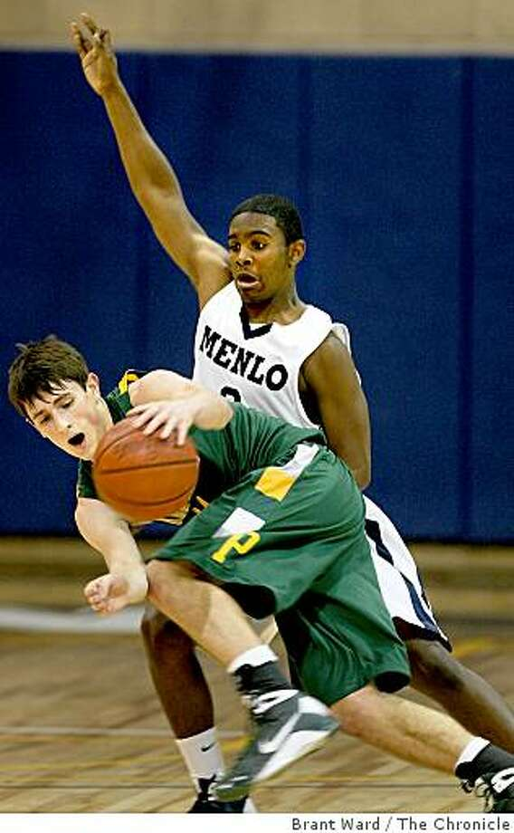 Jerry Rice Jr. (right) forced a turnover with Pinewood's Connor Whitlock. High School boys basketball: Pinewood visits Menlo School in Atherton, CA Tuesday February 17, 2009. Menlo High School was victorious. Photo: Brant Ward, The Chronicle