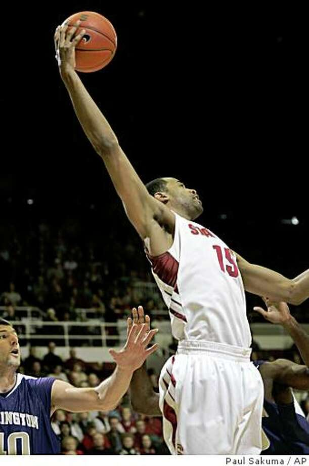 Stanford forward Lawrence Hill (15) grabs the rebound in front of Washington forward Jon Brockman (40) in the first half of an NCAA college basketball game in Stanford, Calif., Sunday, Feb. 8, 2009. (AP Photo/Paul Sakuma) Photo: Paul Sakuma, AP