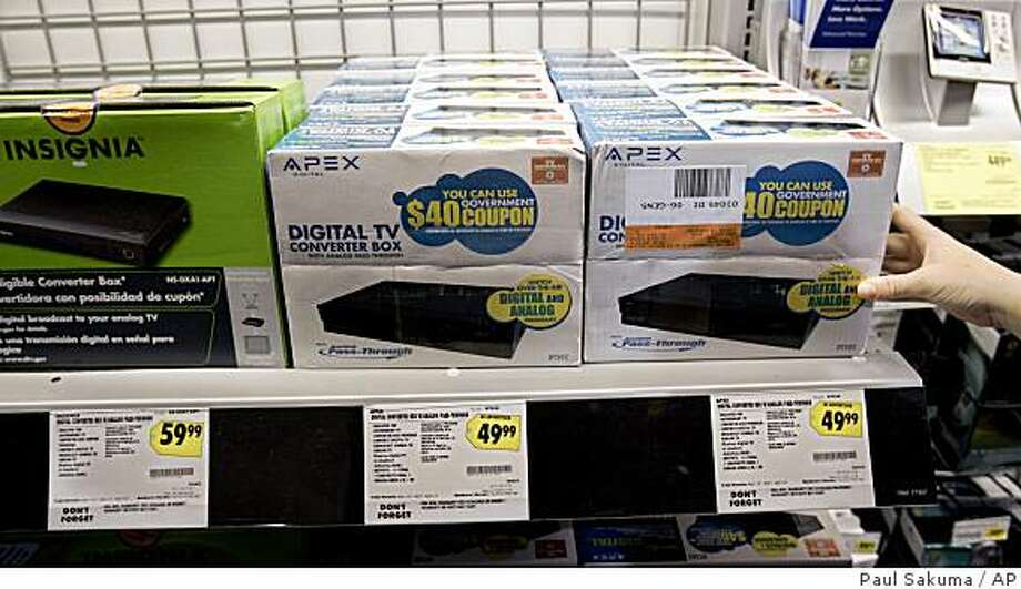 ** FILE ** In this Feb. 4, 2009 file photo, a display of digital TV converter boxes is seen at Best Buy in Mountain View, Calif. Although the government delayed the mandatory shutdown of analog TV signals by four months to give people with older TVs more time to prepare, that's small comfort to people who live in cities where some broadcasters are switching to all-digital broadcasts Tuesday, as they had originally planned. (AP Photo/Paul Sakuma, file) Photo: Paul Sakuma, AP