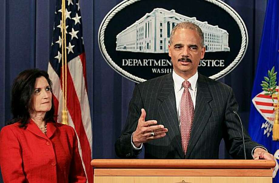 WASHINGTON - OCTOBER 04:  Attorney General Eric Holder (R) and Assistant Attorney General for the Antitrust Division Christine Varney speak during a press conference announcing an antitrust lawsuit against major credit card companies at the Justice Department on October 4, 2010 in Washington, DC. The lawsuit challenges the rules that American Express, Master Card and Visa have in place to prevent merchants from offering consumer discounts, rewards and information about card costs. Photo: Mark Wilson, Getty Images