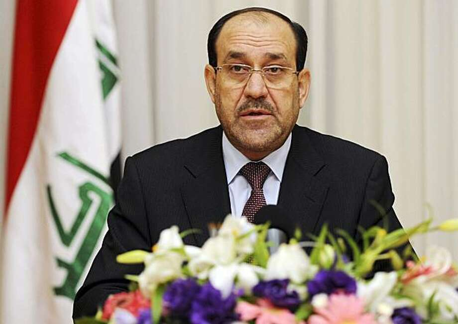 In this photo released by the Iraqi Government, Iraqi Prime Minister Nuri al-Maliki, speaks to the press in Baghdad, Iraq, Wednesday, Dec. 9, 2009. (AP Photo/Iraqi Government) Photo: Iraqi Government, AP