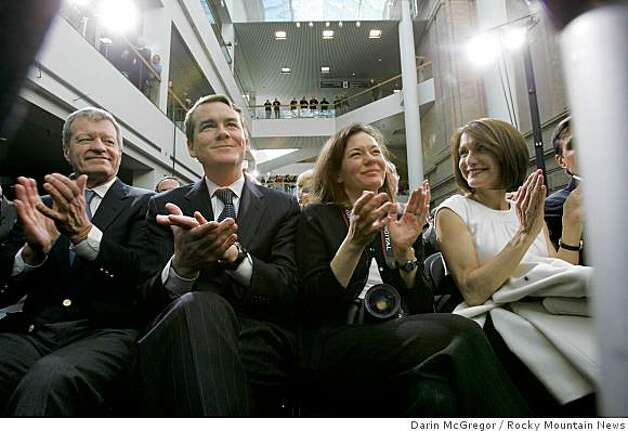 Sen. Michael Bennet, D-Colo., and his wife, Susan, center, applaud President Barack Obama as he speaks at the Museum of Nature and Science in central Denver on Tuesday, Feb. 17, 2009 before signing a $787 billion economic stimulus bill. Photo: Darin McGregor, Rocky Mountain News
