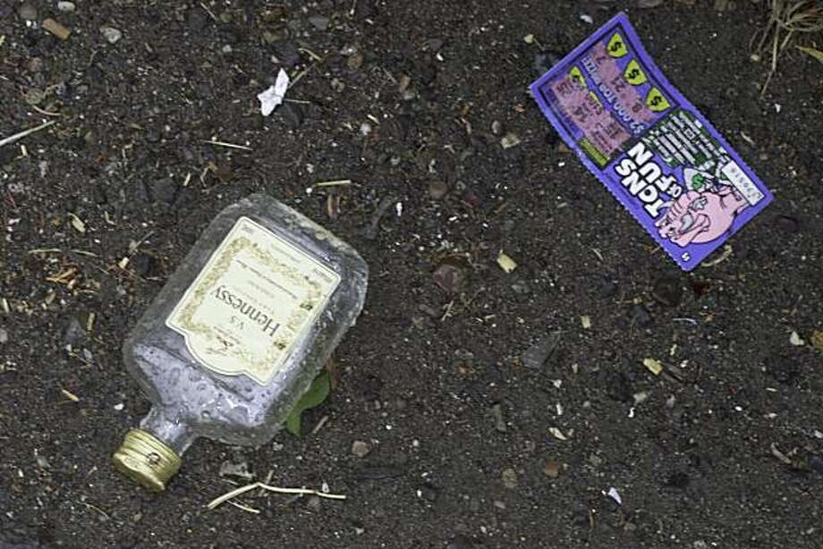 An empty Hennessey bottle and a lottery ticket litter the parking lot at Jack's Market in Bay Point, the center of a controversy over the store's application for a liquor license in a community already saturated with liquor stores. Photo: Kat Wade, The Chronicle