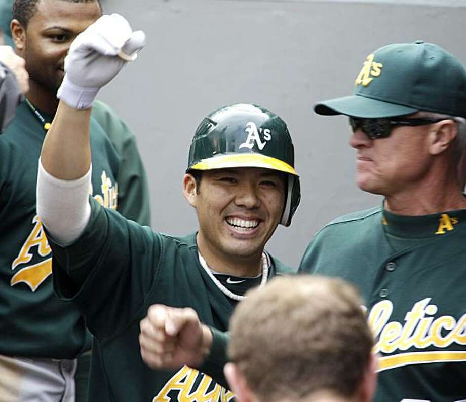 Oakland Athletics' Kurt Suzuki celebrates in the dugout after hitting a solo home run against the Seattle Mariners in the second inning of a baseball game, Sunday, Oct. 3, 2010, in Seattle. Photo: Ted S. Warren, AP