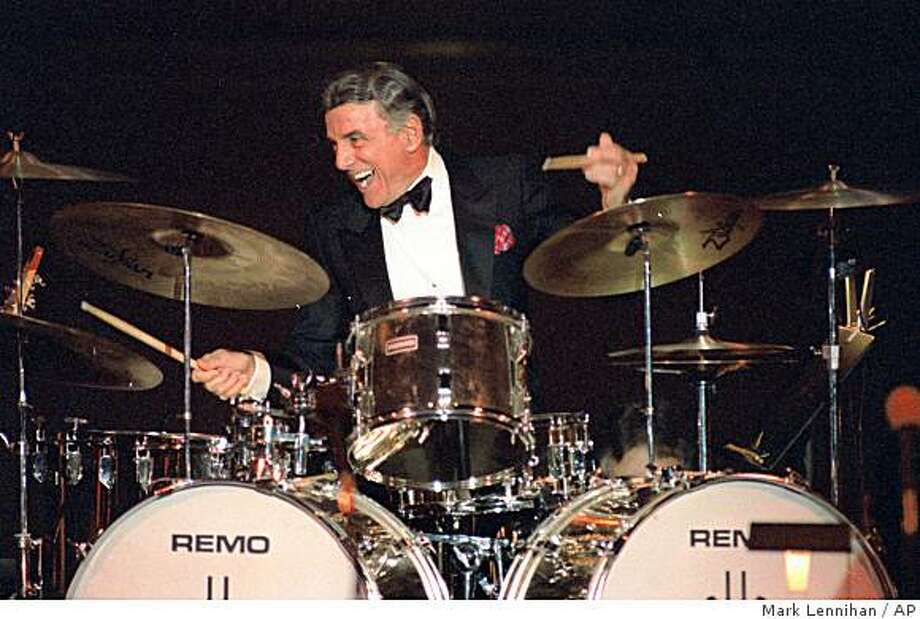 **FILE** In this Aug. 21, 1989 file photo, Louis Bellson plays drums at a jazz festival concert in Carnegie Hall in New York. Bellson died Saturday Feb. 14, 2009,at Cedars-Sinai Medical Center in Los Angeles.   (AP Photo/Mark Lennihan, File) Photo: Mark Lennihan, AP