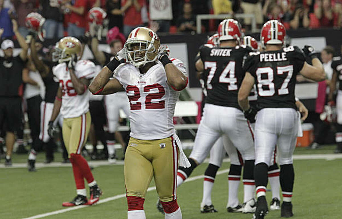 San Francisco 49ers defender Nate Clements (22) reacts as Atlanta Falcons players celebrate a last-second field goal that gave them a 16-14 win in an NFL football game at the Georgia Dome in Atlanta, Sunday, Oct. 3, 2010.
