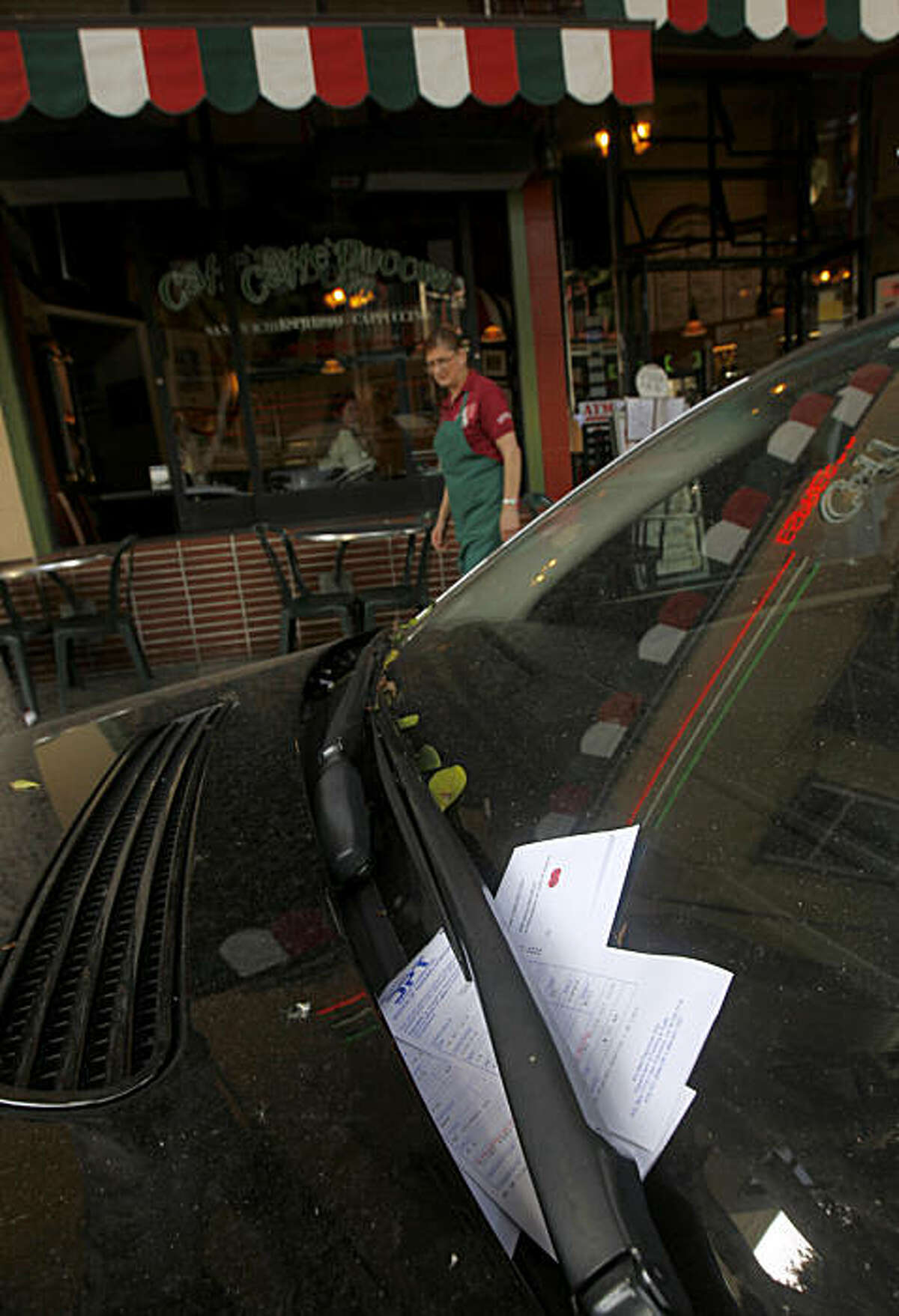 Several parking citations have been issued to a car that has been parked at an expired meter for over a day in front of Caffe Puccini on Columbus Avenue in San Francisco, Calif., on Wednesday, Oct. 6, 2010.