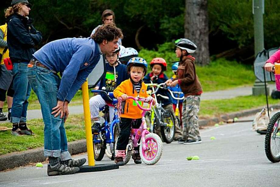 Ben Caldwell of the YBike Program helps kids navigate the Bike Road-eo course. Photo: Kate McCarthy