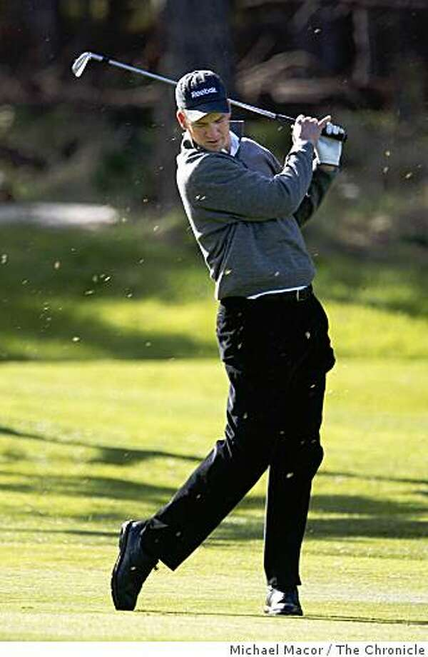 Peyton Manning looks towards the ground as he miss-hits a shot on the first hole during 1st round action at the AT&T Pebble Beach National Pro-Am on Thursday Feb. 12, 2009, Spyglass Hill golf course in Pebble Beach, Calif. Photo: Michael Macor, The Chronicle