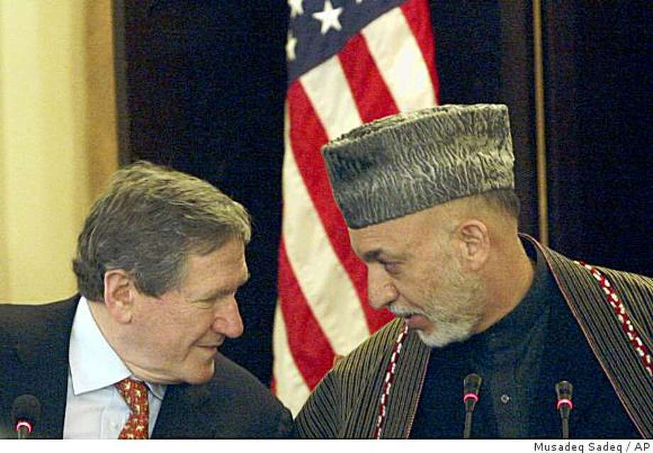 Afghan President Hamid Karzai, right, whispers to U.S. Special Representative to Pakistan and Afghanistan Richard Holbrooke ahead of the starting a news event at the presidential palace in Kabul, Afghanistan on Sunday, Feb. 15, 2009. (AP Photo/Musadeq Sadeq) Photo: Musadeq Sadeq, AP
