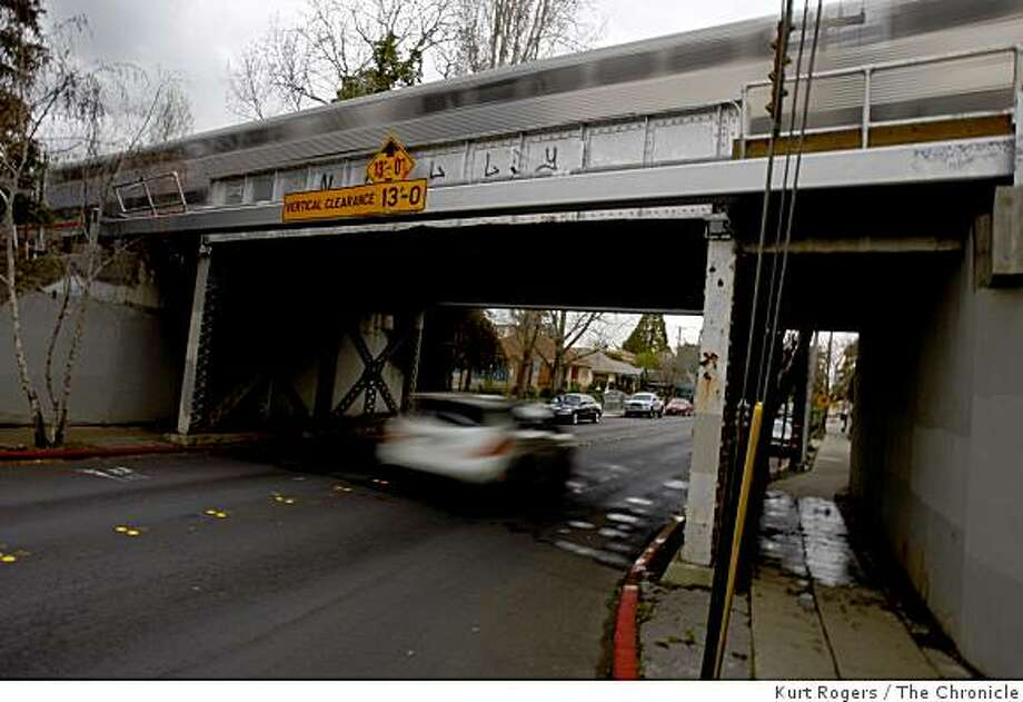 The Caltrain railroad bridge that crosses Poplar Avenue in San Mateo will be one of four bridges replaced because of the stimulus bill passed by Congress. A train passes on the bridge on Thursday, Feb. 12,  2009 in San Mateo, Calif. Photo: Kurt Rogers, The Chronicle