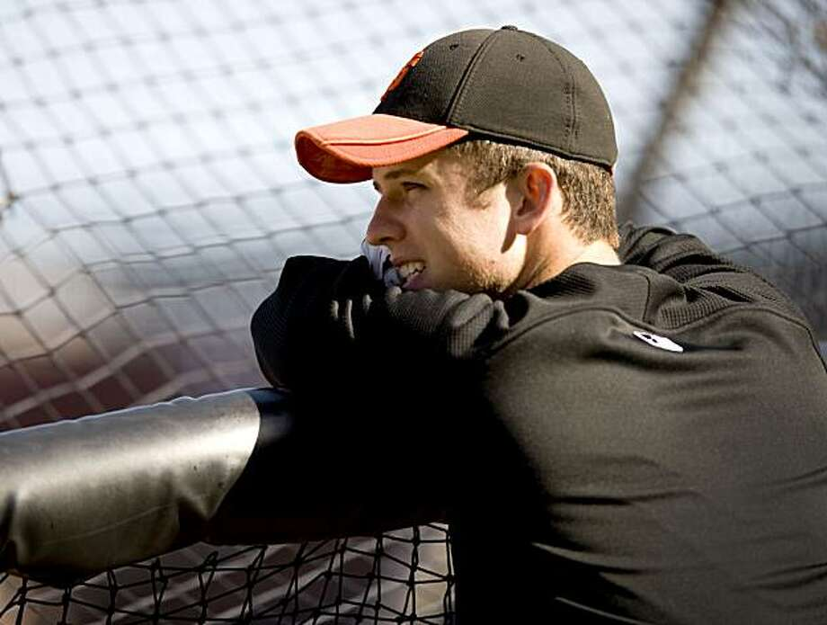 Buster Posey leans on the cage during batting practice prior to the San Francisco Giants playing the Arizona Diamondbacks at AT&T Park in San Francisco, Calif., on Friday, August 27, 2010. Photo: Chad Ziemendorf, The Chronicle
