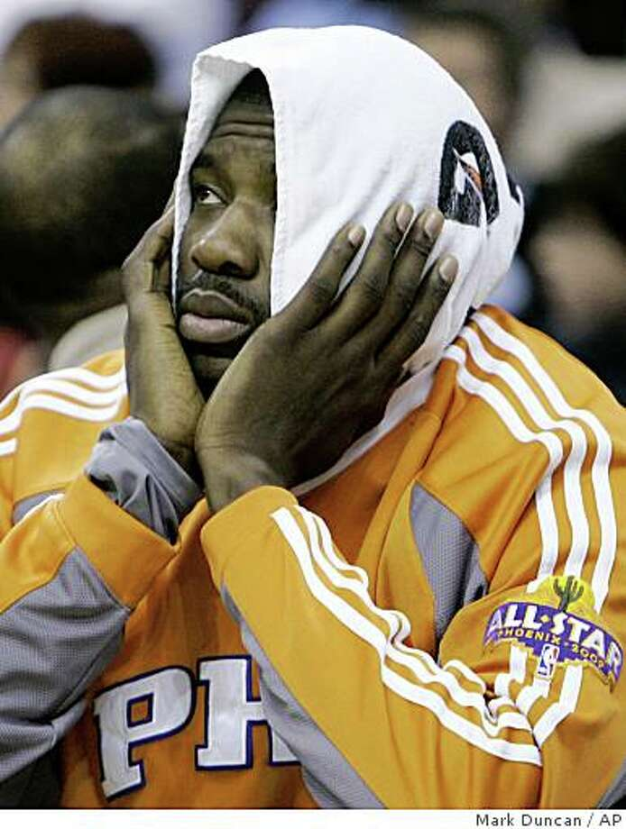 Phoenix Suns' Amare Stoudemire looks on from the bench during the fourth quarter of a 109-92 loss to the Cleveland Cavaliers in an NBA basketball game Wednesday, Feb. 11, 2009, in Cleveland. (AP Photo/Mark Duncan) Photo: Mark Duncan, AP