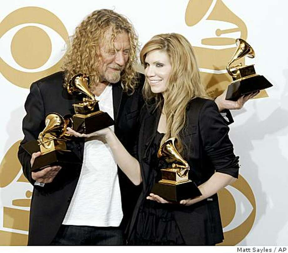Robert Plant, left, and Alison Krauss hold their album of the year and best pop collaboration with vocals awards backstage at the 51st Annual Grammy Awards on Sunday, Feb. 8, 2009, in Los Angeles. (AP Photo/Matt Sayles) Photo: Matt Sayles, AP