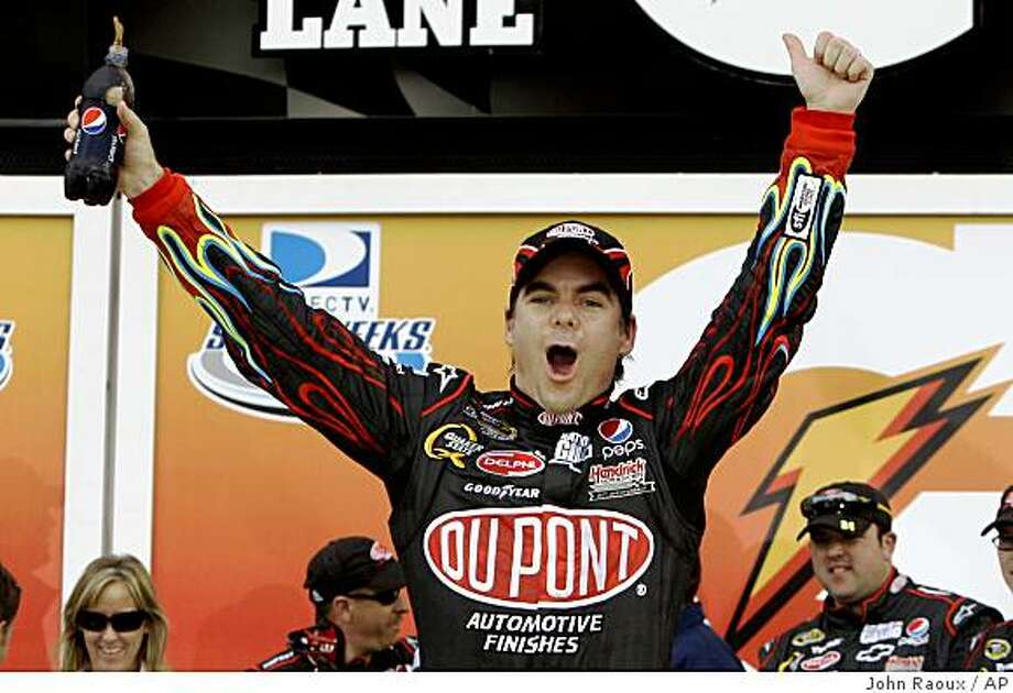 Jeff Gordon celebrates in victory lane after winning the first of two NASCAR Gatorade Duel 150 qualifying races at the Daytona International Speedway in Daytona Beach, Fla., Thursday, Feb. 12, 2009. Photo: John Raoux, AP