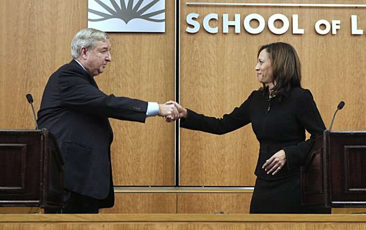 Los Angeles County District Attorney Steve Cooley, left, the Republican candidate for Attorney General, shakes hands with his Democratic opponent, San Francisco County District Attorney Kamala Harris following their debate at the University of California,Davis, School of Law in Davis, Calif., Tuesday, Oct. 5, 2010.