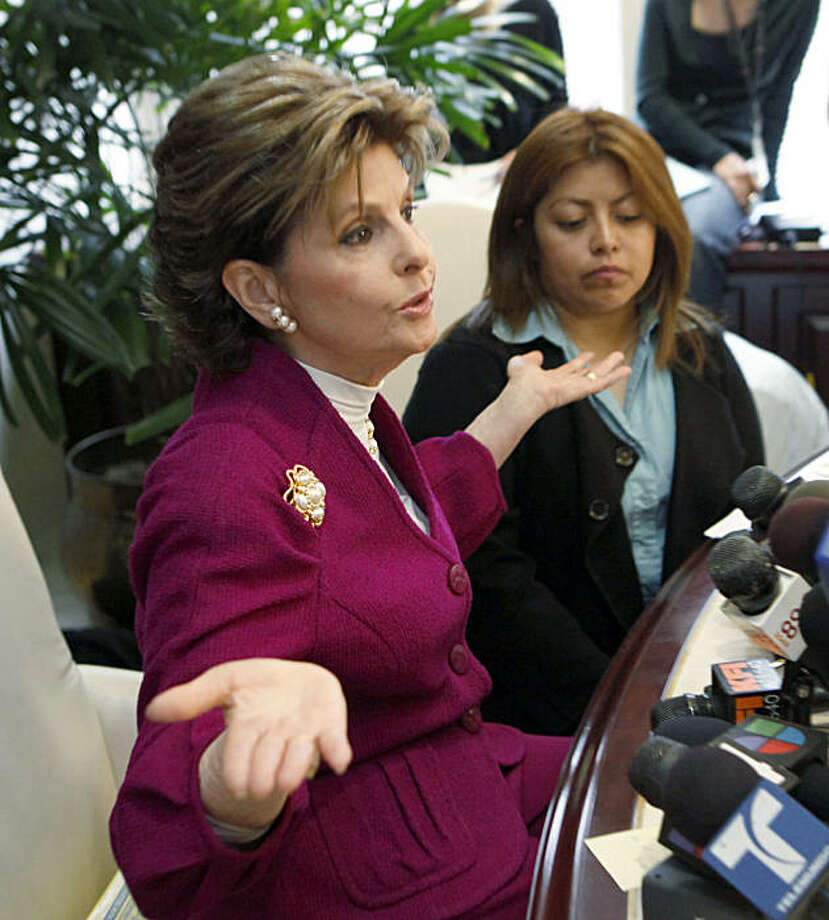 Nicky Diaz Santillan, right, former housekeeper for California Republican gubernatorial candidate Meg Whitman, listens as her attorney Gloria Allred talks with reporters in Los Angeles Tuesday, Oct. 5, 2010. Photo: Reed Saxon, AP