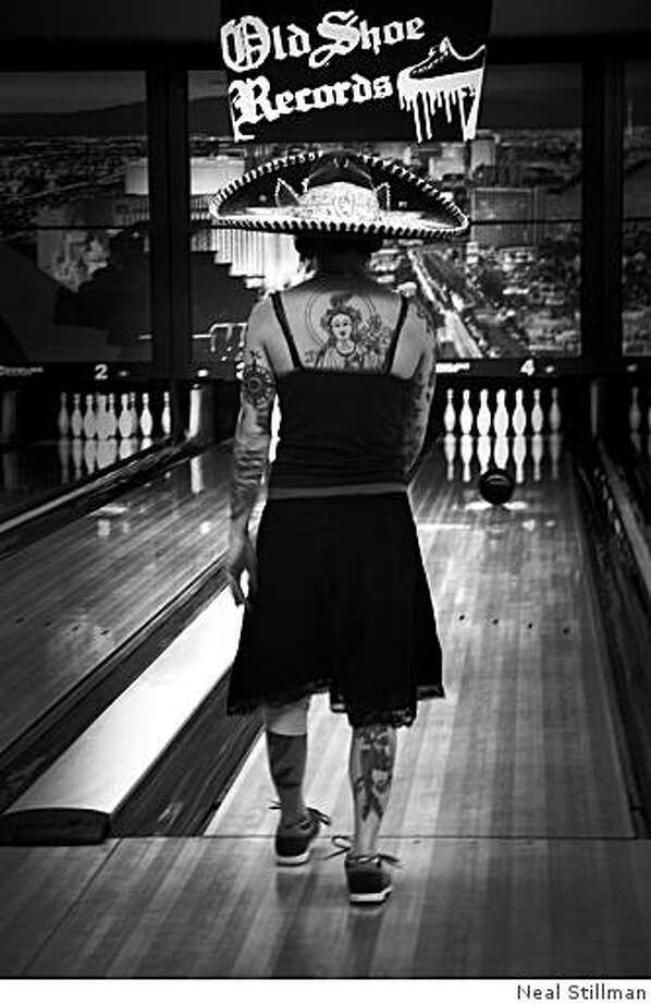 A bowler in the punk bowling tournament prepares for her turn at Sam's Town in Las Vegas. (still efforting the id friday night) Photo: Neal Stillman
