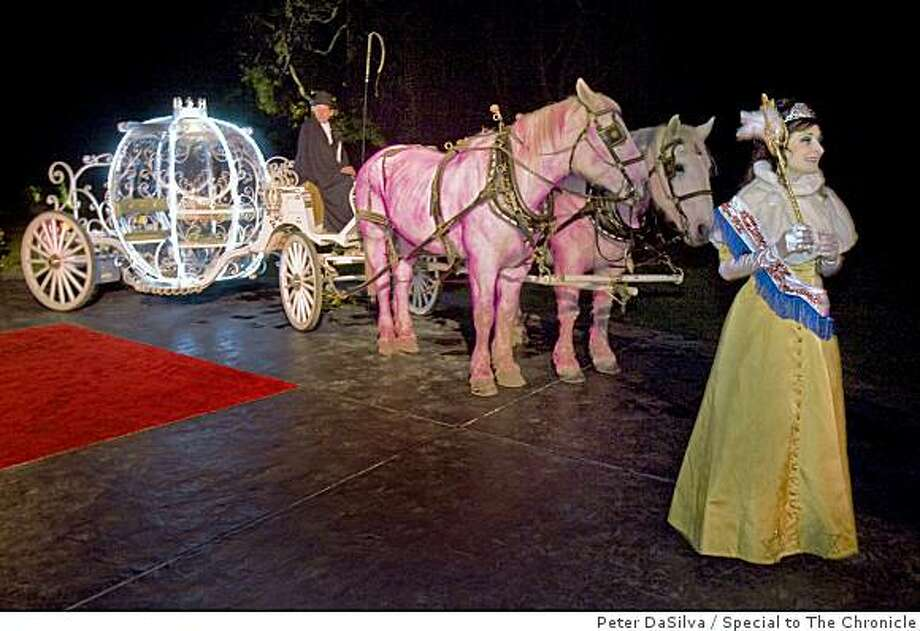Guest to Jillian Manus Salzman husband Alan Salzman $1,000-a-ticket, black tie fundraiser for the Stanford Cancer Center are greeted by a Jewish-American princess and pink horses drawing a carriage for Cinderella at the  front door of their Fairy Tale transformed Atherton, California home on Feb. 7, 2009. Photo: Peter DaSilva, Special To The Chronicle