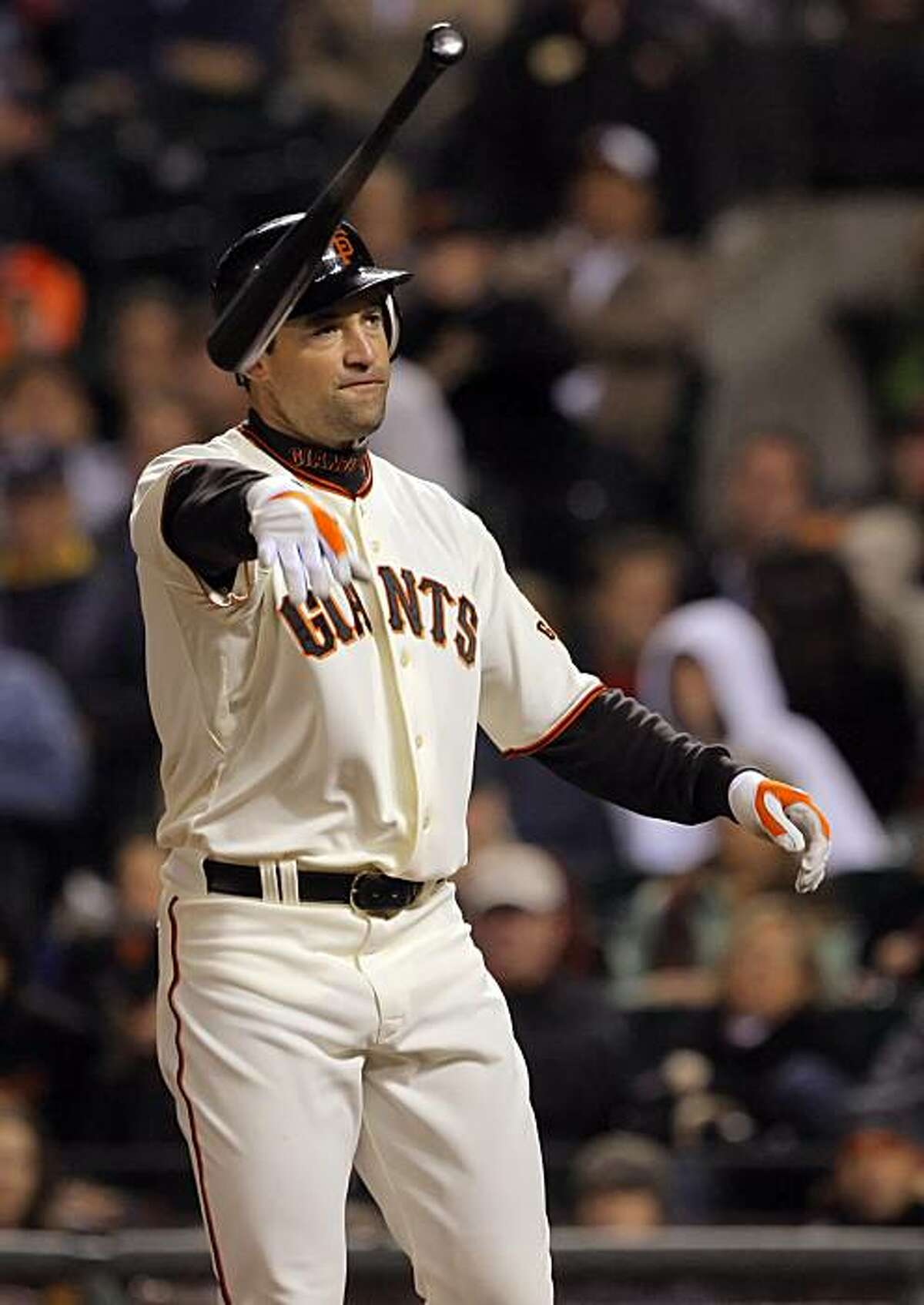 Pat Burrell throws his bat after striking out in the seventh inning Tuesday at AT&T Park.