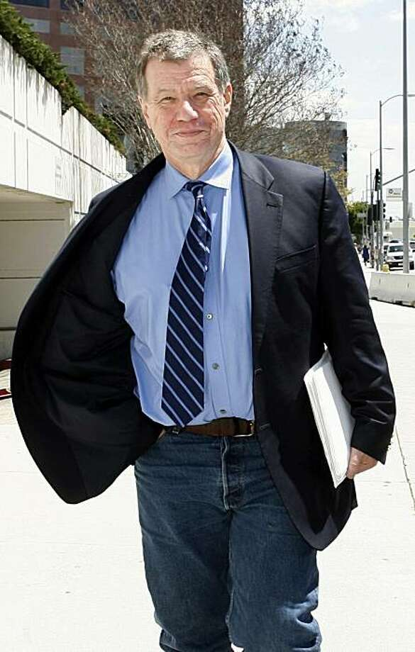 "** FILE ** In this April 17, 2006 file photo, John McTiernan, director of such hit movies as ""Die Hard"" and ""The Thomas Crown Affair,"" leaves federal court in Los Angeles. McTiernan was sentenced in Federal court Monday, Oct. 4, 2010 to one year in prisonand $100,000 fine for lying during a Hollywood wiretapping investigation of private investigator Anthony Pellicano. Photo: Nick Ut, AP"