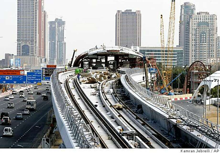 **APN ADVANCE FOR SUNDAY FEB. 15** Workers busy at the construction site of a metro station on Sheikh Zayed highway  in Dubai, United Arab Emirates, Tuesday, Jan. 6, 2009. (AP Photo/Kamran Jebreili) Photo: Kamran Jebreili, AP