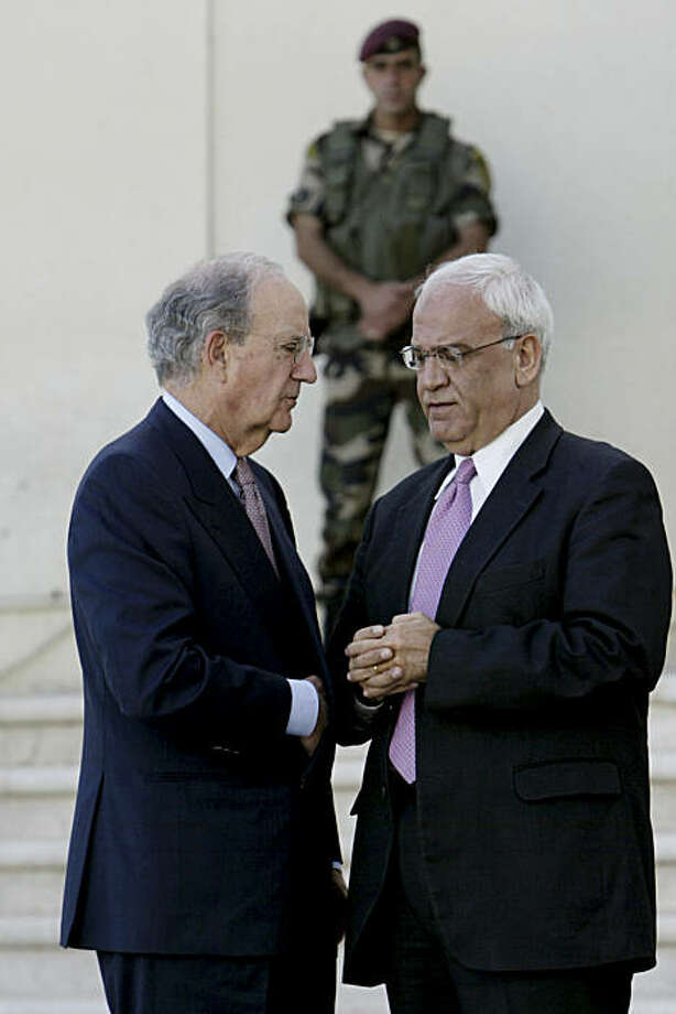 Special Envoy for Middle East Peace George Mitchell, left, and Chief Palestinian negotiator Saeb Erekat, right,are seen after a meeting with Palestinian President Mahmoud Abbas, in the West Bank city of Ramallah  in the West Bank city of Ramallah, Thursday, Sept. 30, 2010.  A U.S. emissary racing against the clock to salvage Mideast peace negotiations scheduled another quick round of meetings with Israeli and Palestinian leaders after talks Thursday with Palestinian President Mahmoud Abbas ended inconclusively. Photo: Majdi Mohammed, AP