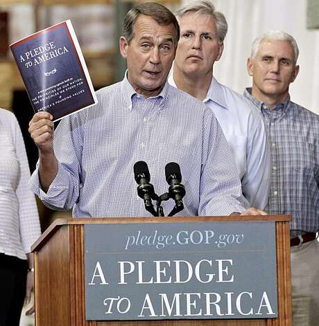 "FILE - In this Sept. 23, 2010 file photo, House Minority Leader John Boehner of Ohio, left, holds up a copy of the GOP agenda, ""A Pledge to America"", at a lumber yard thirty miles from the Capitol in Sterling, Va. Advertised as a Pledge to America, the House Republican campaign maifesto is as much political straddle as conservative call to action, long on goals, deliberately short on controversial specifics and designed to reassure millions of independents who abandoned the party in the last two elections. He is joined by Rep. Kevin McCarthy, R-Calif., center, and Rep. Mike Pence, R-Ind. Photo: J. Scott Applewhite, AP"