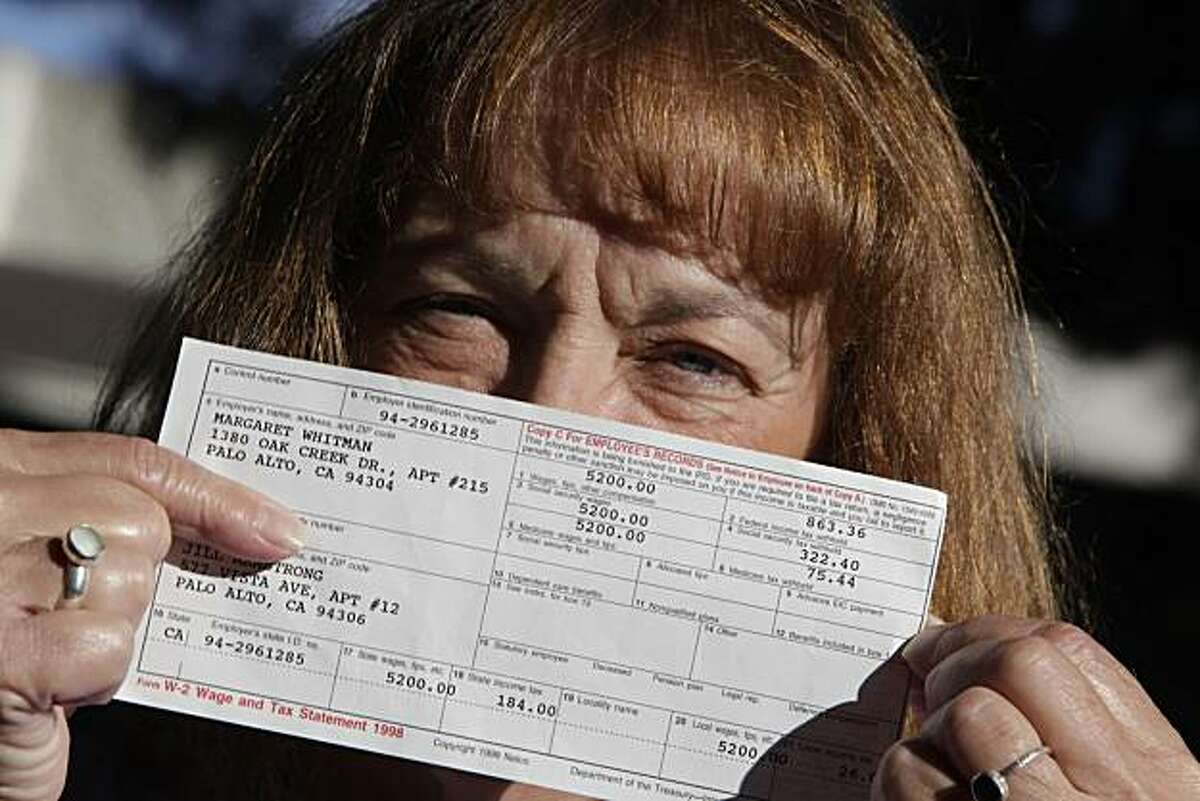 Jill Armstrong of Mountain View, who used to work as a nanny for Meg Whitman is seen with her 1998 W-2 Wage and Tax Statement, on Friday, October 1, 2010 in Mountain View, Calif.