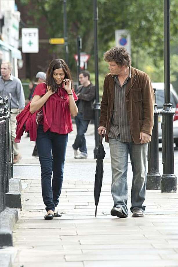 "Left to Right: Freida Pinto as Dia and Josh Brolin as Roy appear in a scene from, ""You Will Meet a Tall Dark Stranger."" Photo: Keith Hamshere, Courtesy Of Sony Pictures Classi"