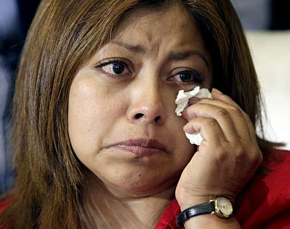 Former housekeeper Nicky Diaz Santillan reacts during a news conference Thursday Sept. 30, 2010 where her attorney Gloria Allred displayed a copy of a purported 2003 letter that shows Republican gubernatorial candidate, Meg Whitman knew all along that Santillan might be an illegal immigrant, keeping the letter from the government after Whitman's husband, Dr. Griffith Harsh, partially filled it out and told the housekeeper to deal with it, in Los Angeles. Photo: Nick Ut, AP
