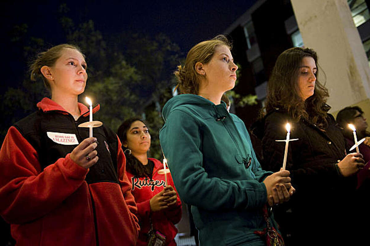 People participate in a candlelight vigil for Rutgers University freshman Tyler Clementi at Brower Commons on the Rutgers campus in New Brunswick, N.J., Sunday, Oct. 3, 2010. Clementi jumped to his death off a bridge a day after two classmates surreptitiously recorded him having sex with a man in his dorm room and broadcast it over the Internet.