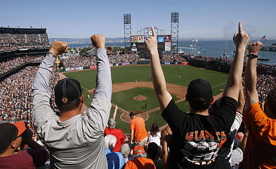Fans in the upper deck go wild after a fifth inning homer by Andres Torres during the San Francisco Giants game against the Arizona Diamondbacks at AT&T Park in San Francisco, Calif., on Thursday, Sept. 30, 2010. The Giants are on the verge of clinching the National League Western Division and an appearance in the post-season. Photo: Paul Chinn, The Chronicle