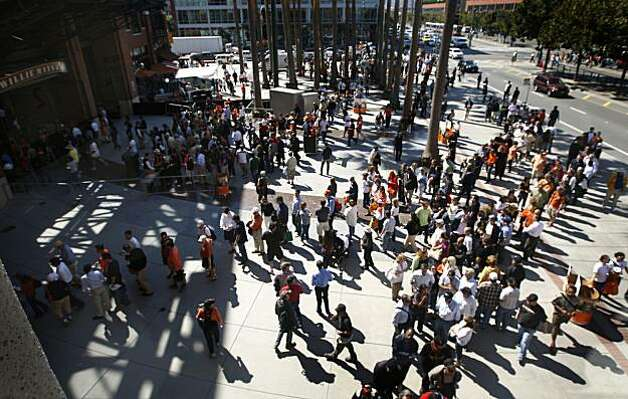Baseball fans stream into Willie Mays Plaza for the San Francisco Giants game against the Arizona Diamondbacks at AT&T Park in San Francisco, Calif., on Thursday, Sept. 30, 2010. The Giants are on the verge of clinching the National League Western Division and an appearance in the post-season. Photo: Paul Chinn, The Chronicle