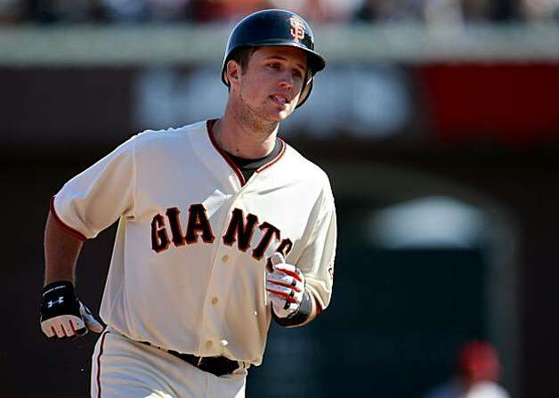 Buster Posey passes third base after hitting a two-run homer in the 6th inning. The San Francisco Giants defeated the Arizona Diamondbacks 4-1 on Thursday September 30, 2010. Photo: Brant Ward, The Chronicle