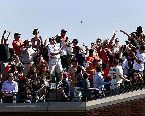 Giant fans in center field try to catch a home run hit by Andres Torres in the 5th inning. The San Francisco Giants defeated the Arizona Diamondbacks 4-1 on Thursday September 30, 2010. Photo: Brant Ward, The Chronicle