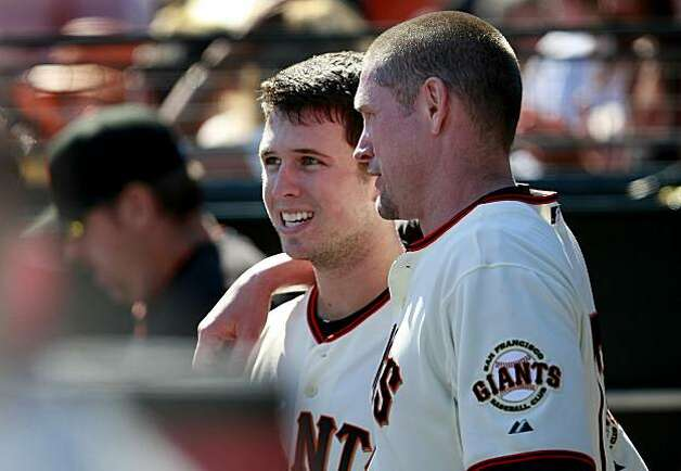 Aubrey Huff (right) put his arm around Buster Posey after Posey's two-run home run, with Huff on base, in the 6th inning. The San Francisco Giants defeated the Arizona Diamondbacks 4-1 on Thursday September 30, 2010. Photo: Brant Ward, The Chronicle