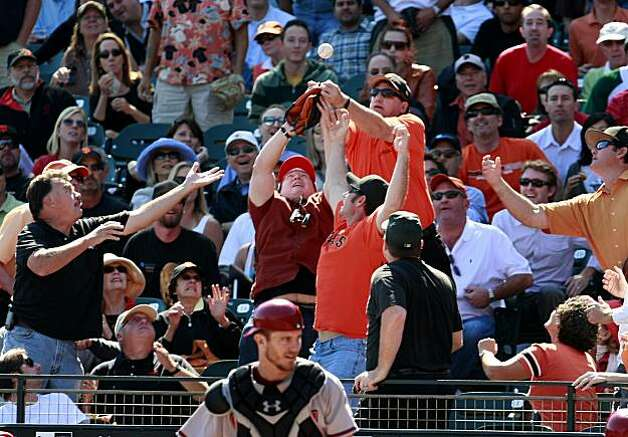 Giants fans wrestle for a foul ball in the third inning. The San Francisco Giants defeated the Arizona Diamondbacks 4-1 on Thursday September 30, 2010. Photo: Brant Ward, The Chronicle