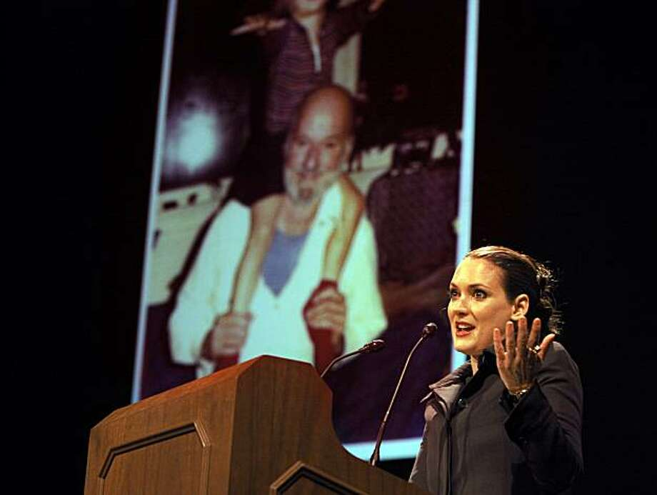 Winona Ryder realizes that the projected photo is of her on Ferlinghetti's shoulders as a child after reciting on of his poems at the Herbst Theatre Saturday, October 2, 2010, San Francisco, Calif.  Lawrence Ferlinghetti, poet and cofounder of City Lights Bookstore, is honored with the Barbary Coast Award during Litquake, San Francisco's Literary Festival. Photo: Adm Golub, The Chronicle
