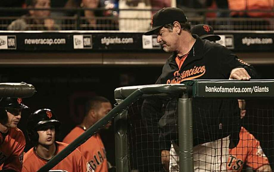 Giants manager Bruce Bochy heads to the clubhouse after San Francisco falls to San Diego 6-4 on Friday. Photo: Michael Macor, The Chronicle